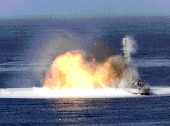 Here a fuel-air explosive is used against a military ship