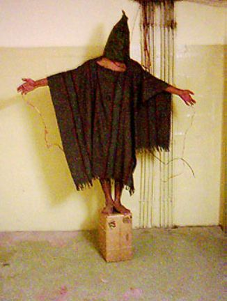 Satar Jabar attached to electrical shocking devices, at Abu Ghraib Prison